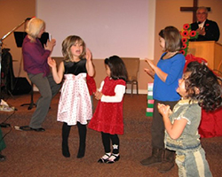 Contributing to the worship service.